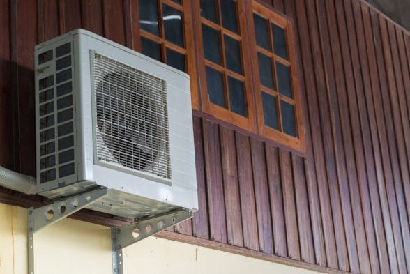 Airconditioning Unit attached in a wooden wall