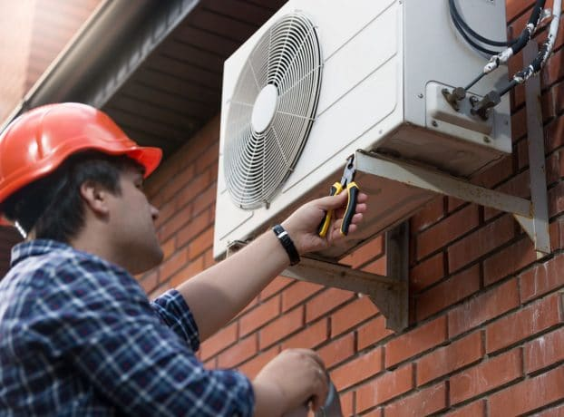Mechanic Repairing a Commercial Air Conditioning Unit