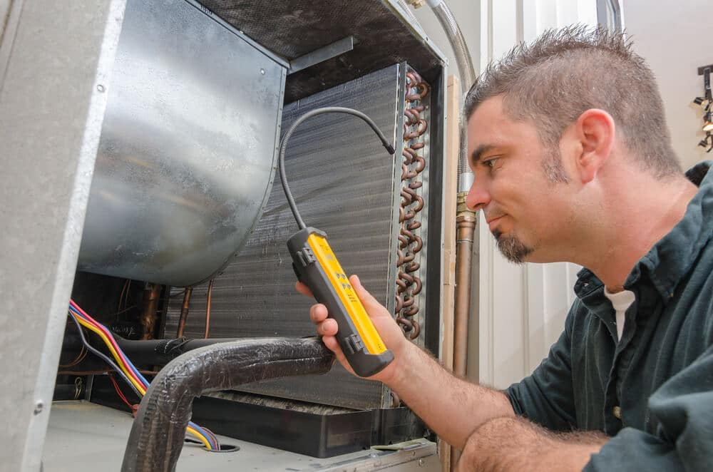 Allen Air & Refrigeration Mechanic Electrical Testing an Airconditioning Unit